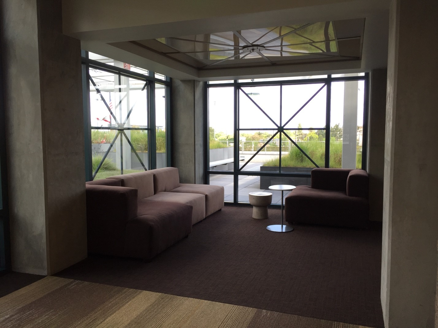Area with chairs next to window.