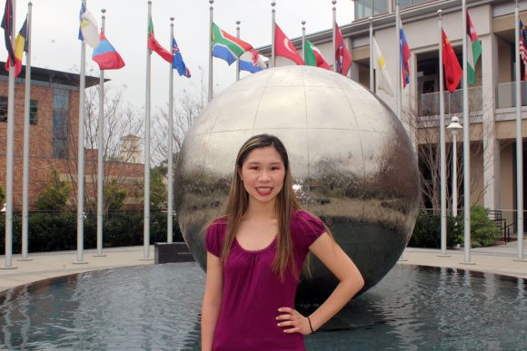 Student in front of Global Citizens Plaza