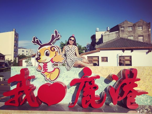 Lindsey posing in a local Taiwanese city.