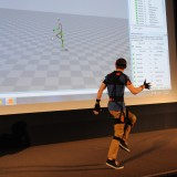 The motion capture software (onscreen) captures every movement he makes, in real time.