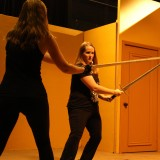 students learning how to sword fight safely as part of interterm stunts class at Dodge College