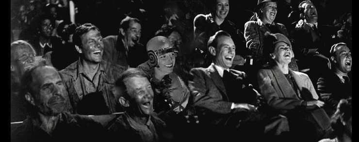 Still of people laughing in an audience
