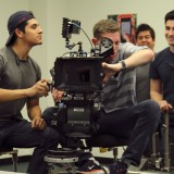 Students pose with camera on the set of a Chapman production