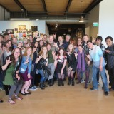 Students pose with Stanton and Catmull at PIXAR studios.