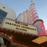 "image of Loews theater marquee that reads ""welcome Chapman University Alumni"""