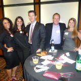 Dodge College alums pose for a photo at an alumni mixer