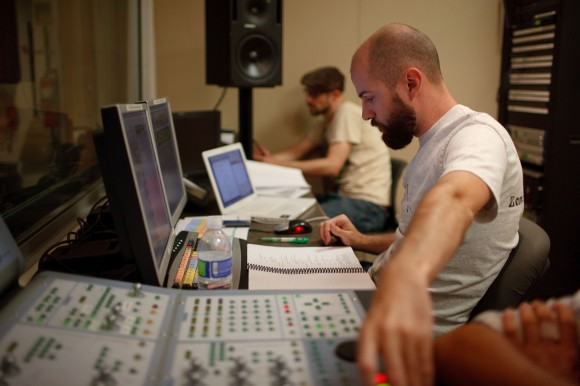 Image of Kc Wayland in the control booth during one of the recording sessions.