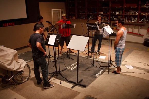 image of actors in the midst of a recording session on the Foley Stage