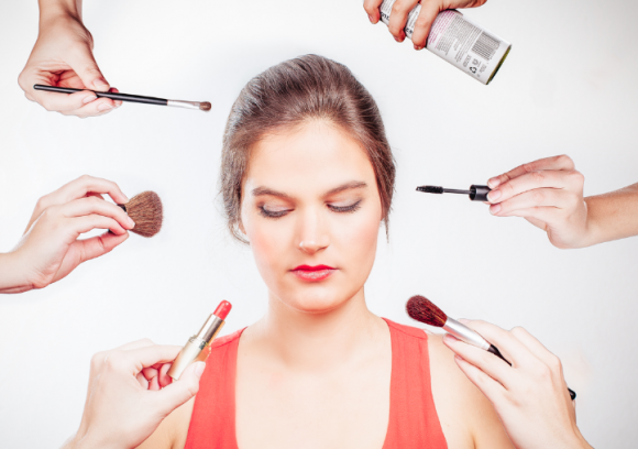 woman surrounded by make up