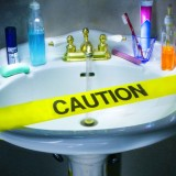 sink covered by caution tape