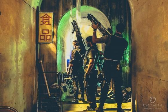 men with guns in futuristic setting