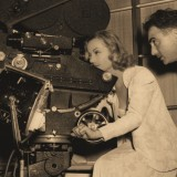 woman at helm of camera in 1930s