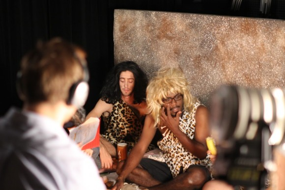 cavemen being filmed
