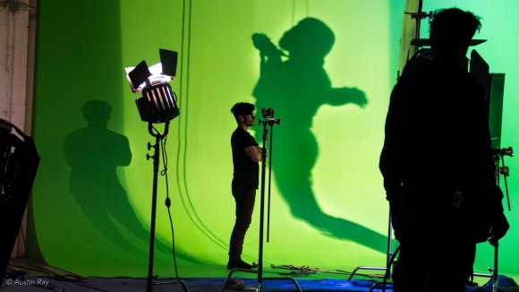 The shadow of a Sandtrooper collides with Wire Rig assistant Luke Couce on the green screen stage
