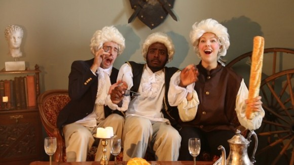 three colonial men sitting around in comedy sketch