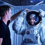 astronaut on set with director