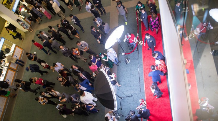 birds eye shot of a group on a red carpet