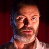 Actor Nick Offerman looks at the camera. Still from, The Greatest, by They Might Be Giants, music video