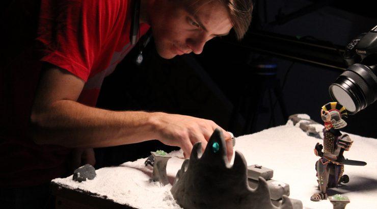 Austin Piko, adjusts elements on the Meraki set.