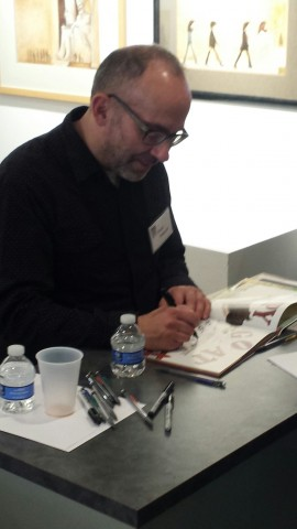 Man signing book.