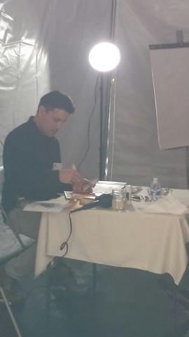 Man demonstrating art technique.
