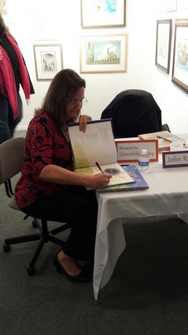 Woman signing book.
