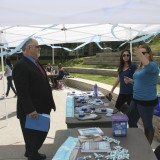 Dean Donald Cardinal, Ph.D., visits the Communications Science and Disorders autisim Awareness tent
