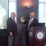 Dean Don Cardinal presenting Dr. Mike Madrid with an award for recognition of outstanding service