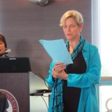 Dr. Gerri McNenny reading limericks to Dr. Mike Madrid