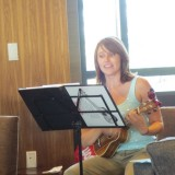 """Erin O'Keefe playing """"Get Together"""" by Youngbloods on her ukulele"""