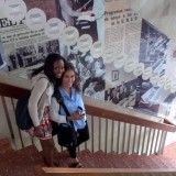 CES Students Kenia and Ashley on the steps of UNED's historical timeline mural.