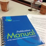 APA manual on desk.