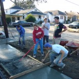 Students working on a sidewalk in New Orleans.
