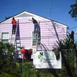 People painting a house in New Orleans.