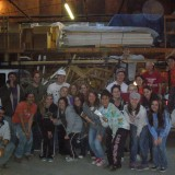 Group of people posing in warehouse.