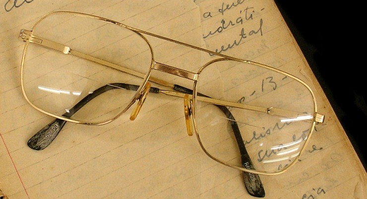Glasses on papers with Paulo Freire's signature