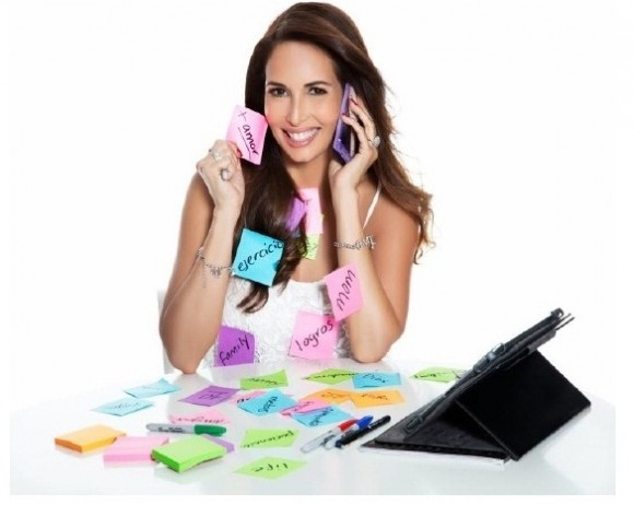 Woman on phone covered in sticky notes.