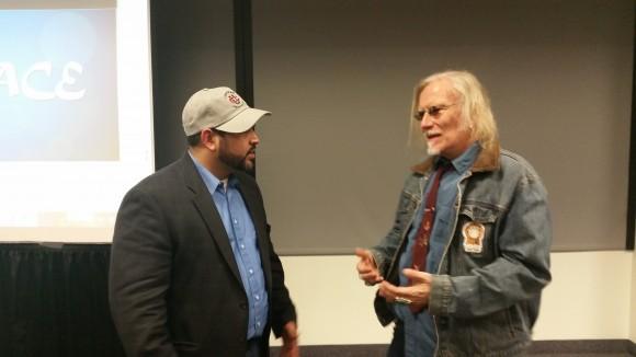 Michael Benitez Jr. (right) speakin with Dr. Peter McLaren (left)