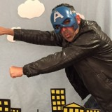 Doctoral student John Naghshineh strikes a superhero pose
