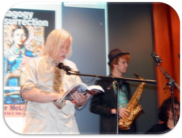 Man reading from book next to man with saxophone.