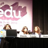 Four people sit at a table with a SXSW edu sign behind them.