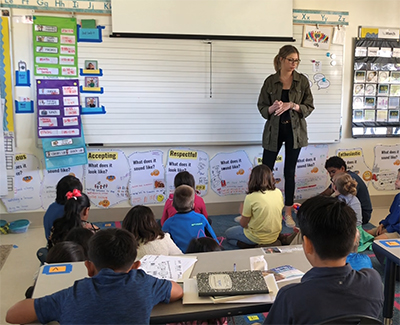 Stephanie Weinfeld teaching youth in a classroom