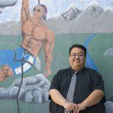 Beau Menchaca in front of mural at Century High School in Santa Ana
