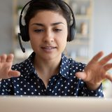 young woman on a laptop with headphones