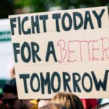 "Protest sign saying ""Fight today for a better tomorrow?"