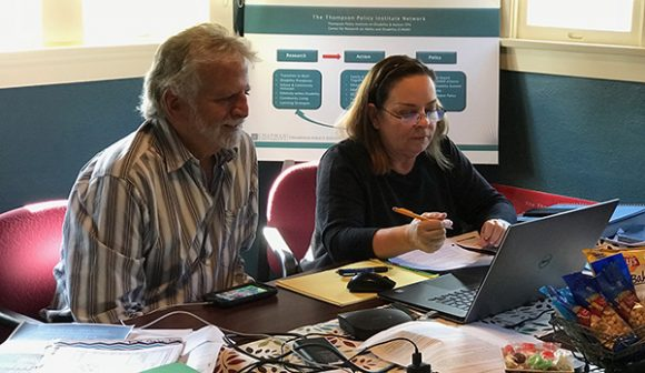 Dr. Richard Rosenberg and Linda O'Neal in Thompson Policy Institute's conference room working on Transition CA resource webpage