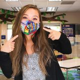Alina Bitter (MACI '21) wear a face covering in an elementary school classroom