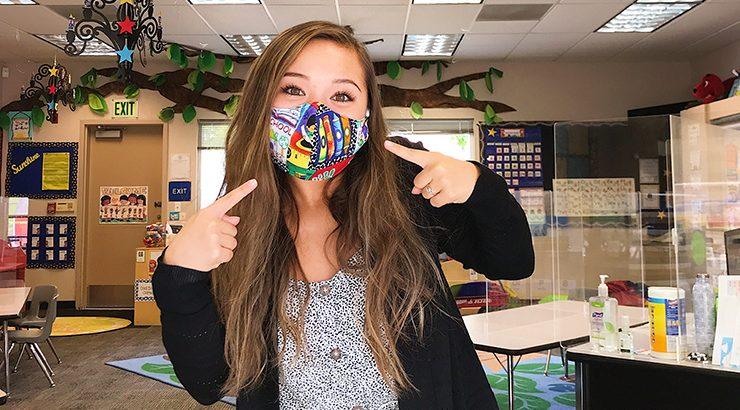 Alina Bitter (MACI '21) wear a face covering in an elementary school classroom