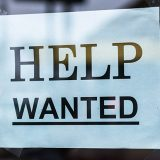 Help Wanted paper sign taped in window
