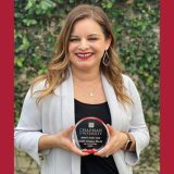 Dr. Audri Sandoval Gomez holding Million Dollar Award